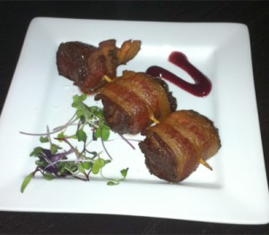 Casa Naranja's Bacon-Wrapped Painted Hills Flat Iron Steak Bites with Cranberry Coulis